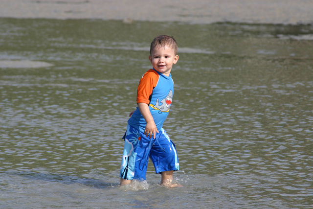 Hunter walking in the ocean