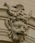 Strange faces on the outside wall of the Louvre