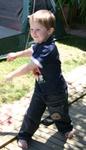Callum throwing a water balloon